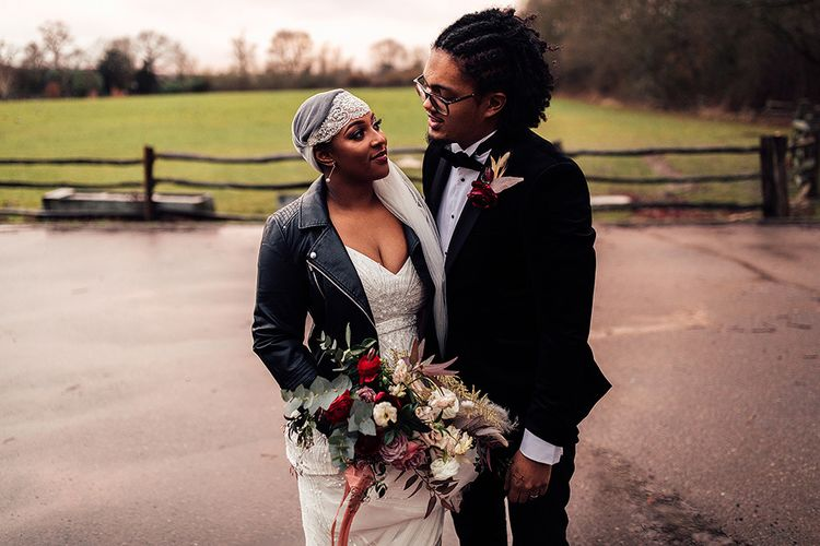 Black Bride in Juliet Cap Veil, Eliza Jane Howell Wedding Dress and Leather Jacket and Groom in Tuxedo