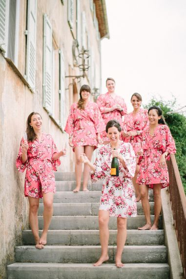 Bridal Party Enjoying Champagne in Matching Getting Ready Robes