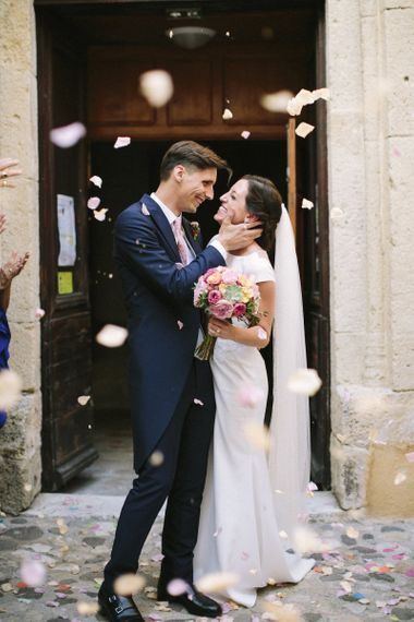 Bride in Rime Arodaky Wedding Dress and Groom in Traditional Morning Suit