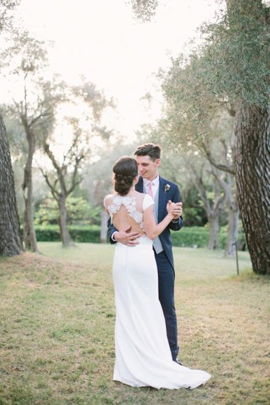 Bride in Rime Arodaky Wedding Dress with Beautiful Decor and Groom in Navy Blue Morning Suit