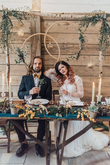 Bride & Groom Sweetheart Table with Hoop Backdrop | Taper Candles | Vintage Crockery & Cut Glass | Geometric Wedding Decor & Styling by Locate to Create at The Cherry Barn | Rebecca Carpenter Photography