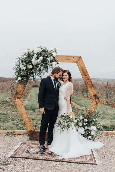 Wooden Hexagonal Moon Gate | Geometric Wedding Decor & Styling by Locate to Create at The Cherry Barn | Rebecca Carpenter Photography