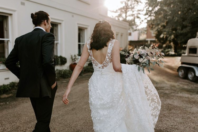Bride dress with low back and lace overlay