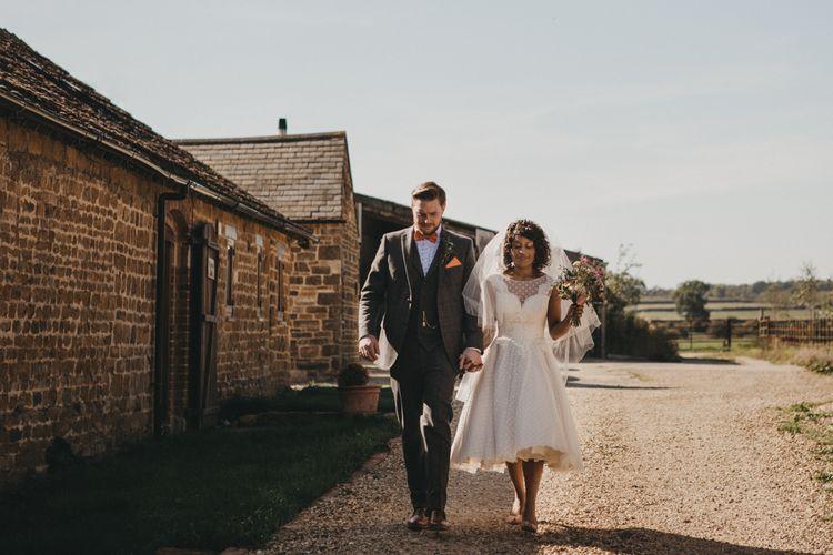 Black Bride in Polka Dot Tea Length Wedding Dress  and Groom in Wool Suit