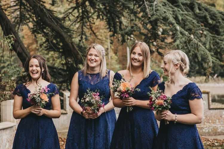 Bridesmaids in Lace Navy Dresses