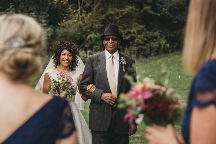 Black Bride and Father of the Bride Approaching the Bridesmaids First Look