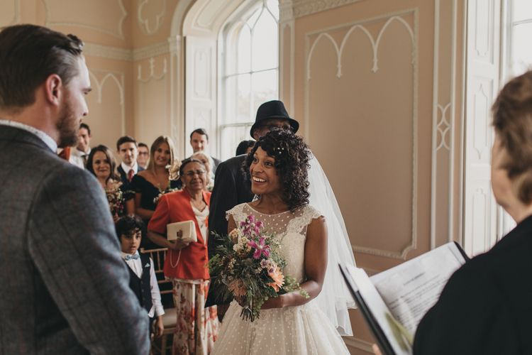 Wedding Ceremony with Bride in Polka Dot Tea Length Wedding Dress and Groom in Grey Check Suit