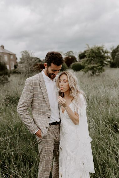 Micro wedding with groom wearing check suit