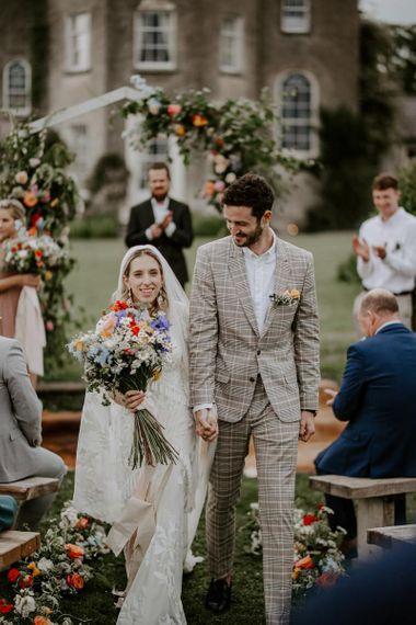 Bride carried wildflower wedding bouquet