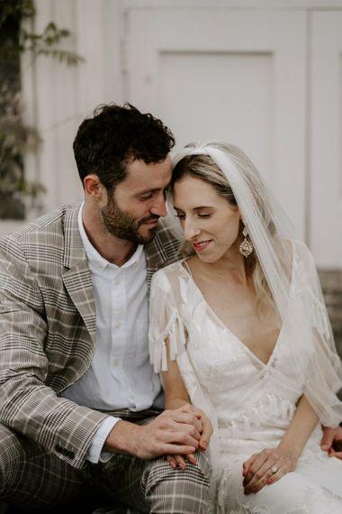 Bride in lace Rue De Seine wedding dress with veil