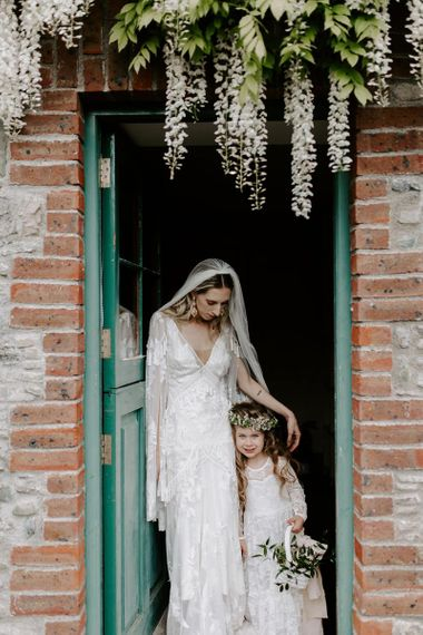 Bride with flower girl at Irish wedding