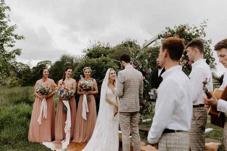 Pink bridesmaid dresses during micro wedding