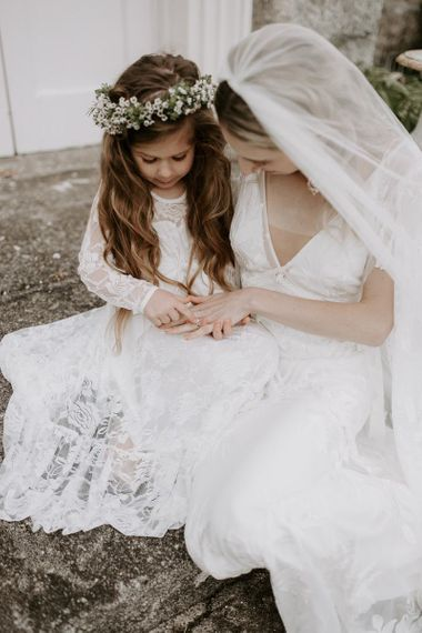 Bride shares a sweet moment with flower girl