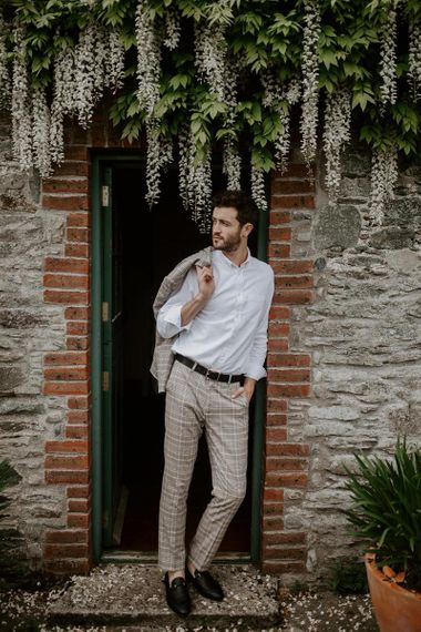 Groom in cream check wedding suit