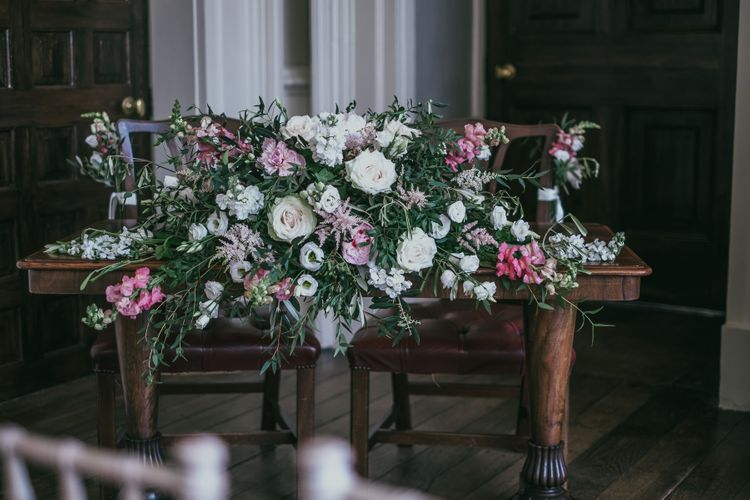 Pink and White Wedding Flower Arrangement for the Registrars Table