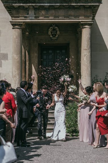 Confetti Moment with Bride in Pronovias Wedding Dress and Groom in Cad & The Dandy Suit