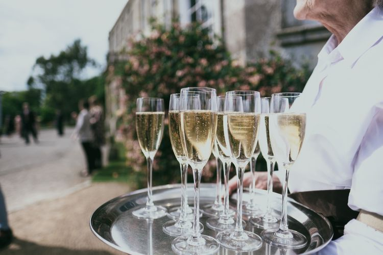 Drinks Reception with Champagne Glasses on a Silver Serving Tray