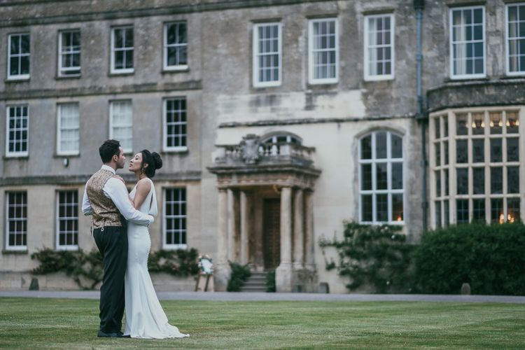 Elegant Bride and Groom Standing infant Of Their Country House Wedding Venue
