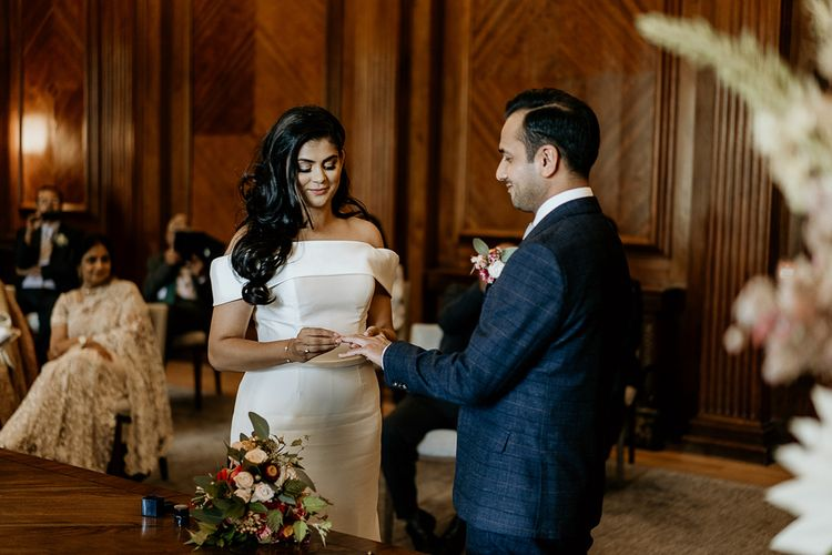 Bride and groom exchanging rings at civil ceremony