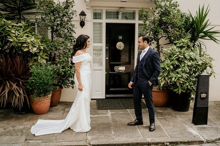 First look with bride in off the shoulder wedding dress