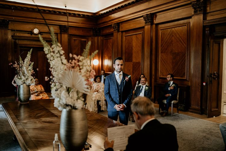 Groom waiting at the altar or Old Marylebone Town Hall wedding ceremony