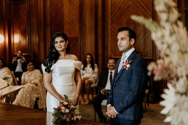 Bride and groom exchange vows at Old Marylebone Town Hall civil ceremony