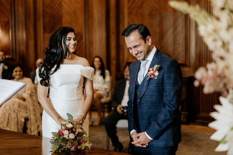 Bride and groom laughing during Old Marylebone Town Hall civil ceremony