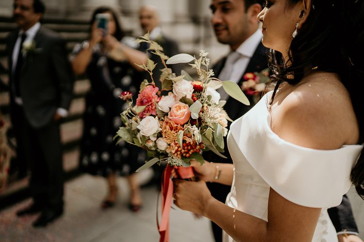 Red, pink and green wedding bouquet