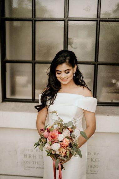 Beautiful Indian bride in off the shoulder wedding dress