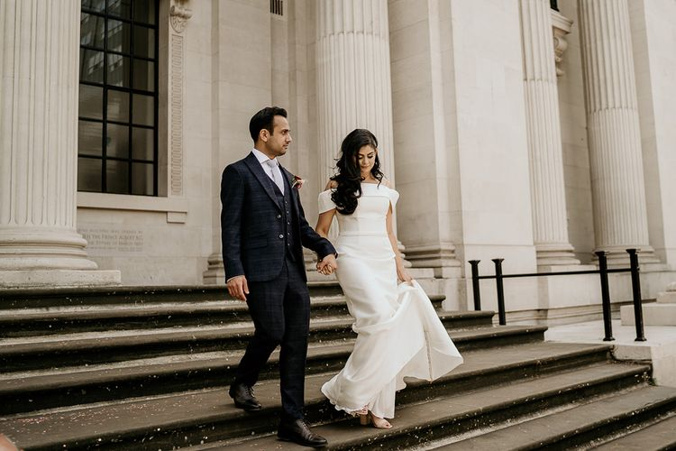 Bride and groom walking down the steps at Old Marylebone Town Hall