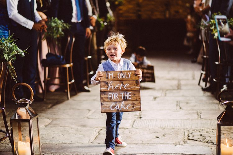 Page Boy With Wooden Sign // Image By Ed Godden
