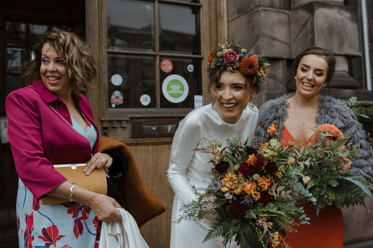 Beautiful Bride in Satin Wedding Dress and Autumn Wedding Bouquet