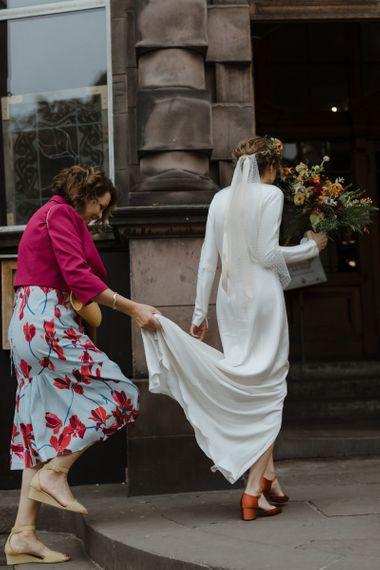 Bride in Satin Wedding Dress, Polka Dot Veil and Orange Wedding Shoes