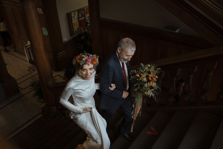 Bridal Entrance in Long Sleeve Satin Wedding Dress with Flower Crown