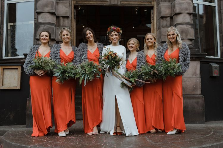 Bridal Party with Bridesmaids in Orange Wedding Dresses, Grey Cover Ups and Bride in Satin Wedding Dress