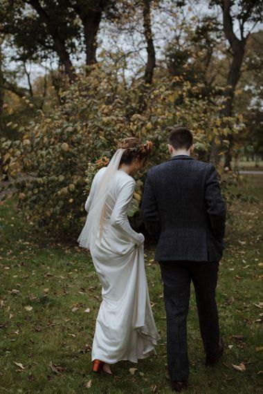 Bride in Satin Wedding Dress and Groom in Wool Suit