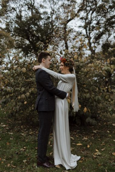 Bride and Groom Portrait with Autumnal Leaves on the Floor