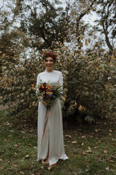 Beautiful Bride in Satin Charlie Bread Wedding Dress, Flower Crown  and Autumnal Wedding Bouquet