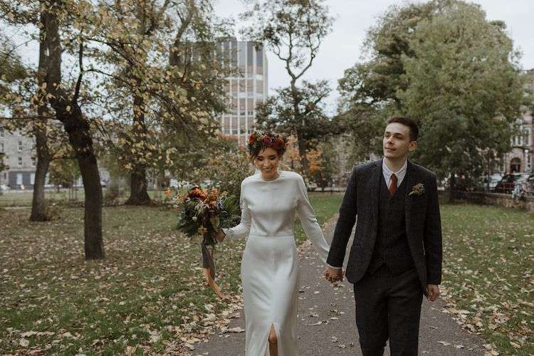 Bride and Groom Autumn Portrait with Leaves on the Ground