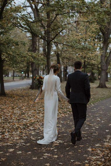 Bride with Polka Dot Wedding Veil and Satin Wedding Dress