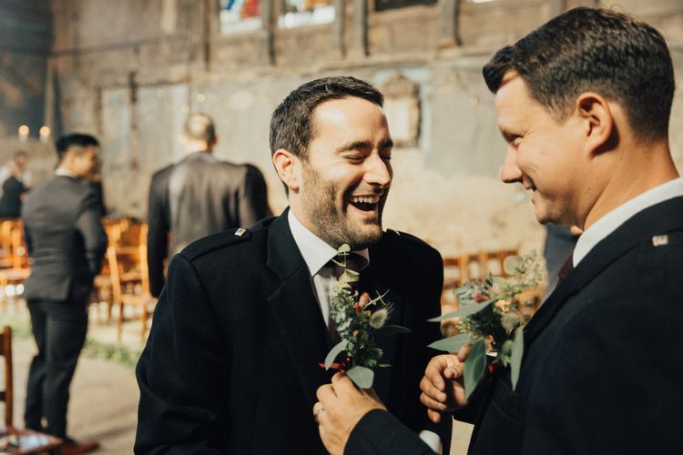 Groom Laughing Putting On his Buttonhole