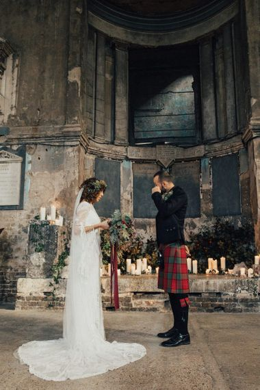 Emotional Groom in Red Tartan Kilt Wiping His Tears as His Bride in a Boho Rue De Seine Wedding Dress Reads Her Wedding Vows
