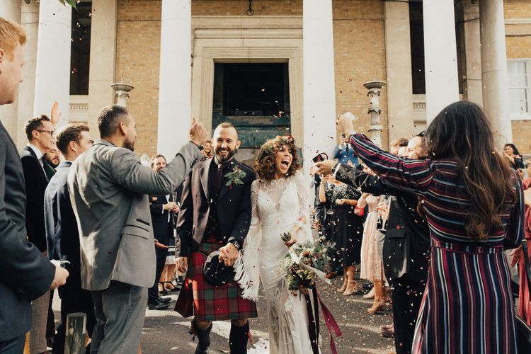 Confetti Moment with Bride in a Boho Rue De Seine Wedding Dress and Groom in Red Tartan Kilt