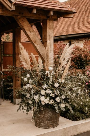 Pampas grass, foliage and white flower floral arrangement