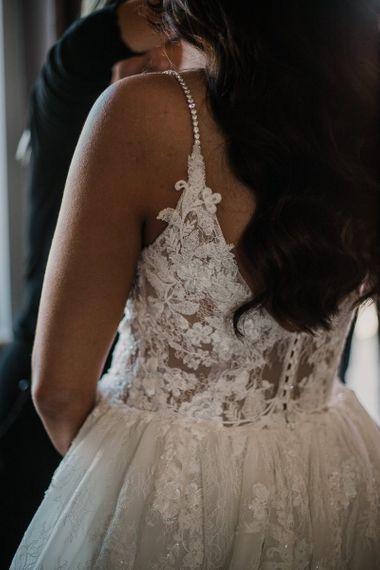 Lace details on Enzoani wedding dress