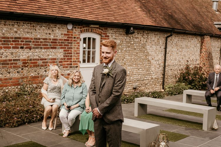 Groom at the altar of socially distanced 2020 wedding