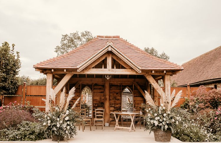 Outdoor pergola at Southend Barns decorated with dried flower arrangement