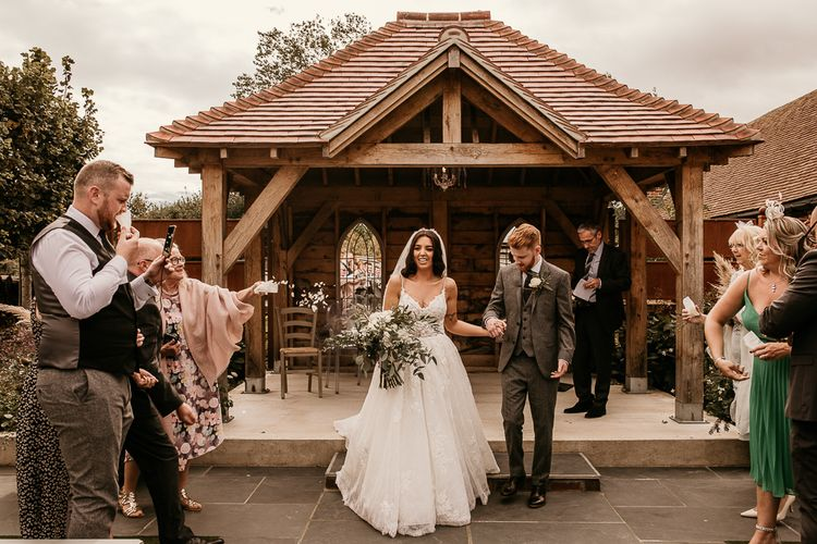Bride and groom just married at intimate outdoor wedding ceremony