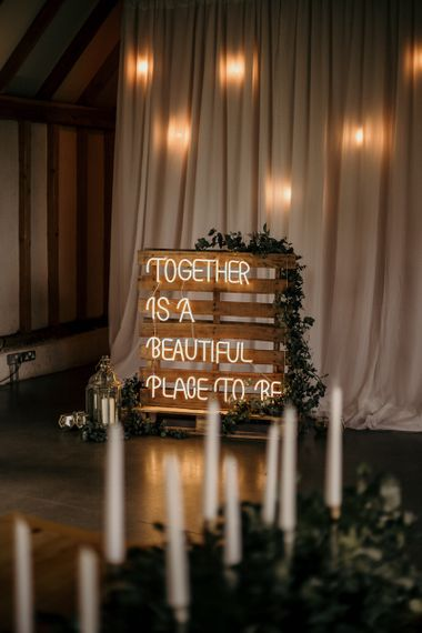 Together is a beautiful place to be neon wedding sign on wooden palette