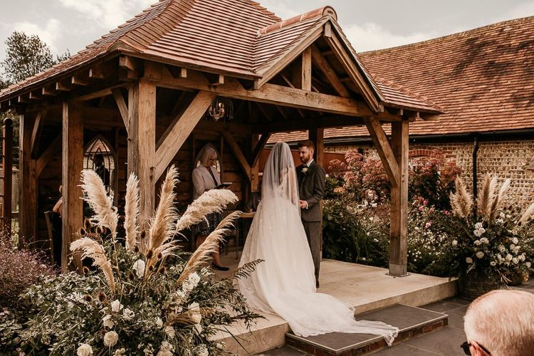Outdoor wedding ceremony at Southend Barns wedding venue